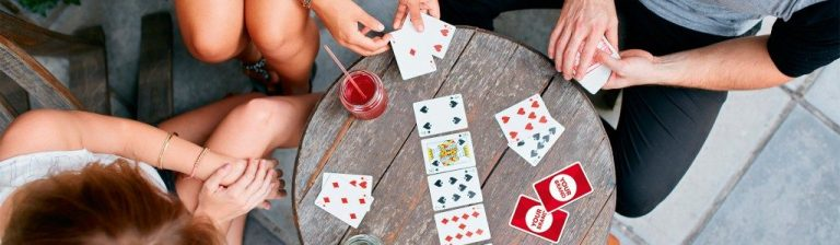 People Playing Together With Playing Cards